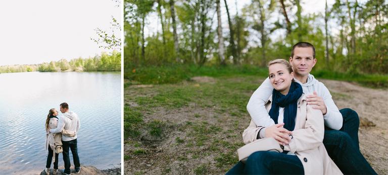 Paar umarmt sich und steht am Wasser von einem See