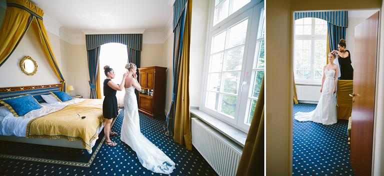 Braut bekommt den Brautschleier angelegt