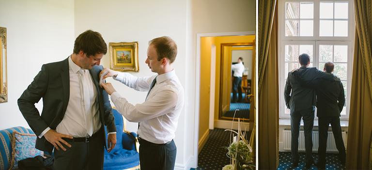Bräutigam bekommt Einstecktuch in den Anzug gesteckt